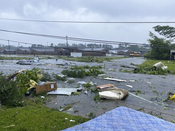 Debris covering the street in East Brewton, Ala., after tropical storm Claudette demolished or badly damaged at least 50 homes in the small town just north of the Florida border. (Alicia Jossey via AP)