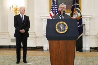 President Joe Biden, left, listens as Attorney General Merrick Garland, right, speaks during an event in the State Dining room of the White House in Washington, Wednesday, June 23, 2021, to discuss gun crime prevention strategy. (AP Photo/Susan Walsh)