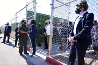 Kamala Harris talks to Gloria Chavez, Chief Patrol Agent of the El Paso Sector, as she tours the U.S. Customs and Border Protection Central Processing Center, Friday, June 25, 2021, in El Paso, Texas. (AP Photo/Jacquelyn Martin)