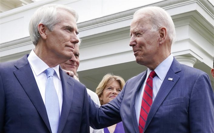 Joe Biden speaks with Sen. Rob Portman (R-Ohio) left, and other bipartisan group of senators outside the White House in Washington after Biden invited members of the group of 21 Republican and Democratic senators to discuss an infrastructure plan. (AP Photo/Jacquelyn Martin, File)