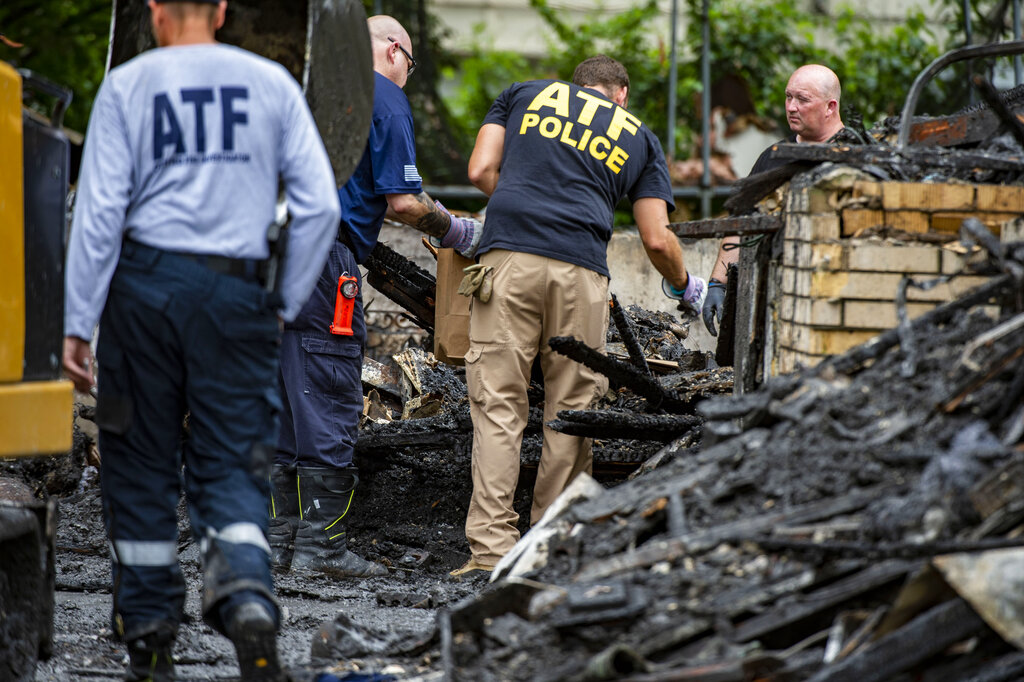 Various law enforcement agencies were on the scene at a duplex in Raytown, Mo., to investigate the cause of an explosion that happened Monday night that killed one person and injured several others. (Rebecca Slezak/The Kansas City Star via AP)