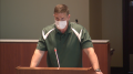 """Leesburg Elementary School physical education teacher Byron """"Tanner"""" Cross addresses the Loudoun County School Board during the public comment portion of the May 25 meeting."""