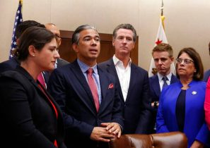 Assemblyman Rob Bonta, D-Oakland, second from left, flanked by California Gov. Gavin Newsom, center, and other lawmakers, discusses his measure banning the use of for-profit, private detention facilities in 2019. Newsom is considering him, along with Mayor Darrell Steinberg and others, to replace Attorney General Xavier Becerra. RICH PEDRONCELLI AP PHOTO