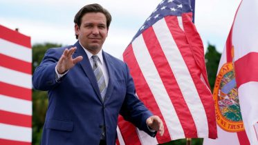 Florida Gov. Ron DeSantis attends an event with President Donald Trump on the environment at the Jupiter Inlet Lighthouse and Museum, Tuesday, Sept. 8, 2020, in Jupiter, Fla. (AP Photo/Evan Vucci)