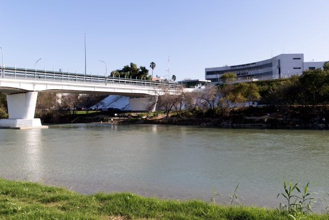 This photo shows the International Bridge and border crossing into Nuevo Laredo, Mexico, behind the Rio Grande River as seen from Laredo, Texas. (Photo credit: SUZANNE CORDEIRO/AFP via Getty Images)
