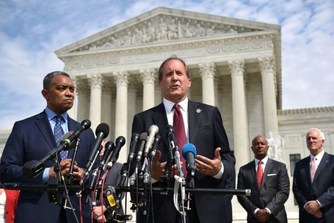 """District of Columbia Attorney General Karl Racine (L) and Texas Attorney General Ken Paxton speak during the launch of an antitrust investigation into large tech companies outside of the US Supreme Court in Washington, DC on September 9, 2019. - The backlash against Big Tech heads into a new phase Monday with another broad antitrust investigation, highlighting the mounting legal challenges facing the dominant online platforms. Top legal officials from dozens of US states were set to unveil a probe of Google over allegations of """"anticompetitive behavior,"""" days after a separate coalition announced a similar investigation of social networking giant Facebook. (Photo by MANDEL NGAN / AFP) (Photo by MANDEL NGAN/AFP via Getty Images)"""