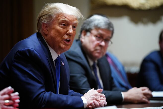 President Donald Trump, left, with former Attorney General William Barr, right, in the Cabinet Room of the White House in Washington, D.C. (Photo by MANDEL NGAN / AFP) (Photo by MANDEL NGAN/AFP via Getty Images)