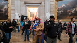 Protestors walk around in the Rotunda after breaching the US Capitol in Washington, DC, January 6, 2021. - Demonstrators breeched security and entered the Capitol as Congress debated the 2020 presidential election Electoral Vote Certification. (Photo by SAUL LOEB / AFP) (Photo by SAUL LOEB/AFP via Getty Images)