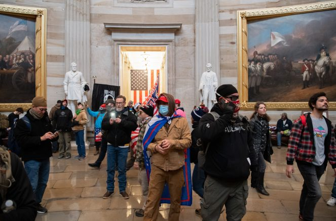 Protestors walk around in the Rotunda after breaching the US Capitol in Washington, DC, January 6, 2021. (Photo by SAUL LOEB/AFP via Getty Images)