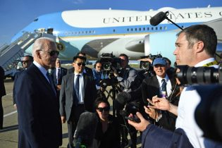 Joe Biden, left, speaks to members of the media at Heathrow, west of London, on June 13, 2021, having attended the G7 summit and visited Britain's Queen Elizabeth II at Windsor Castle. (Photo by Brendan Smialowski / AFP) (Photo by BRENDAN SMIALOWSKI/AFP via Getty Images)