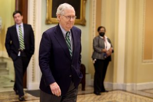 WASHINGTON, DC - MAY 24: Senate Minority Leader Mitch McConnell (R-KY) leaves the Senate Chambers after giving a floor speech on May 24, 2021 in Washington, DC. This week the Senate is to continue talks on infrastructure legislation and a police reform bill before a weeklong Memorial Day recess. (Photo by Anna Moneymaker/Getty Images)