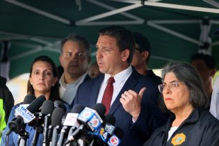 Gov. Ron DeSantis speaks to the media about the 12-story Champlain Towers South condo building that partially collapsed on June 24, 2021 in Surfside, Florida. It is unknown at this time how many people were injured as search-and-rescue effort continues with rescue crews from across Miami-Dade and Broward counties. (Photo by Joe Raedle/Getty Images)