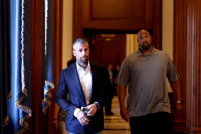 Metropolitan Police Officer Michael Fanone, left, arrives at the office of House Minority Leader Kevin McCarthy (R-Calif.) with U.S. Capitol Police Officer Harry Dunn, right in Washington, DC. (Photo by Anna Moneymaker/Getty Images).