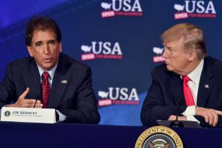 US President Donald Trump listens to US Representative Jim Renacci (L) during a roundtable discussion on the new tax law at the Cleveland Public Auditorium and Conference Center on May 5, 2018, in Cleveland, Ohio. (Photo by Nicholas Kamm / AFP) (Photo credit should read NICHOLAS KAMM/AFP via Getty Images)