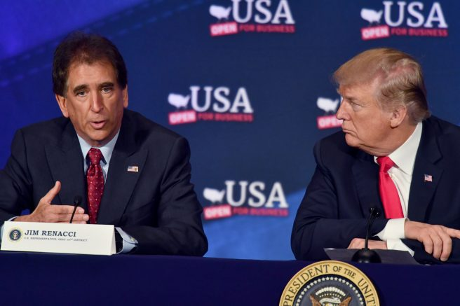 President Donald Trump, right, listens to Jim Renacci, left, during a roundtable discussion in Cleveland, Ohio. (NICHOLAS KAMM/AFP via Getty Images)