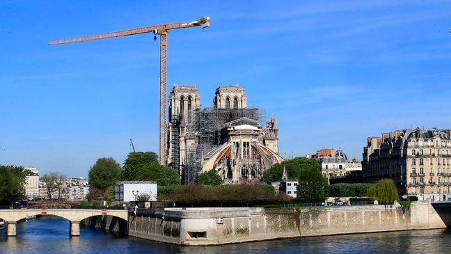 FILE - In this April 15, 2020 file photo, a crane stands by Notre Dame Cathedral Wednesday, April 15, 2020 in Paris. (AP Photo/Michel Euler, File)