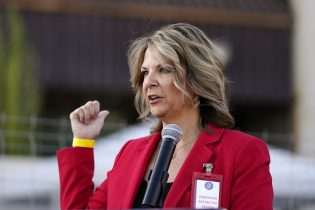 FILE - In this Nov. 18, 2020, file photo, Dr. Kelli Ward, chair of the Arizona Republican Party, holds a press conference in Phoenix. The Arizona Republican Party is confronting its future this weekend after losing a second Senate seat and the presidential race. On the agenda for the state committee meeting Saturday: the reelection bid by its controversial chairwoman, who has been among the most prolific promoters of baseless election conspiracies, and the censure of some of the party's best-known figures: Cindy McCain, former Sen. Jeff Flake and Gov. Doug Ducey. (AP Photo/Ross D. Franklin, File)