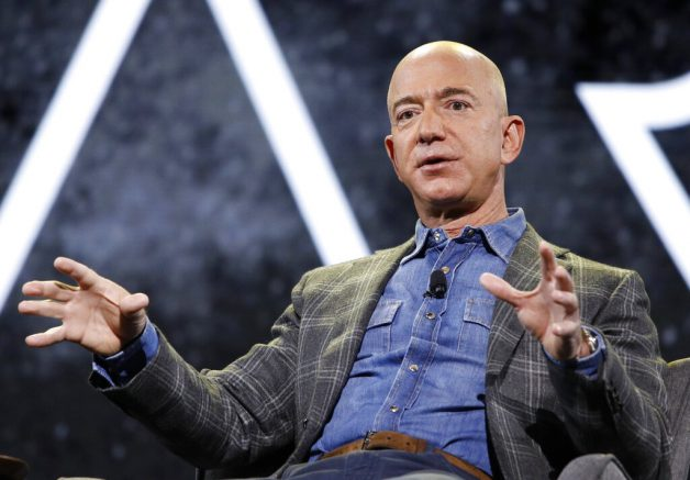 FILE - In this June 6, 2019 file photo, Amazon CEO Jeff Bezos speaks at the the Amazon re:MARS convention, in Las Vegas. Bezos will be aboard for Blue Origin's first human space flight next month. In an Instagram post early Monday, June 7, 2021, Bezos said he, his brother, and the winner of an ongoing auction, will be aboard Blue Origin's New Shepard spacecraft during its scheduled launch on July 20. (AP Photo/John Locher, File)