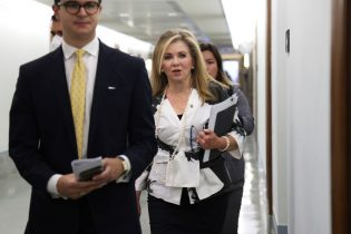 """WASHINGTON, DC - JUNE 22: U.S. Sen. Marsha Blackburn (R-TN) (C) arrives at a hearing before Senate Armed Services Committee at the U.S. Capitol June 22, 2021 in Washington, DC. The committee held a hearing to examine """"The posture of the Department of the Navy in review of the Defense Authorization Request for Fiscal Year 2022 and the Future Years Defense Program."""" (Photo by Alex Wong/Getty Images)"""