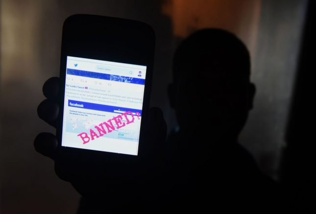 A Sri Lankan man mobile phone user shows an image on Twitter showing that the Facebook site had been blocked in Colombo on March 7, 2018. - Telecommunication service providers said they have blocked access to facebook and several other social media platforms on the directive of the government which accused extremists of using the popular social media to spread hate speech and instigate violence against the Muslim minority in the country. (Photo by ISHARA S. KODIKARA / AFP) (Photo credit should read ISHARA S. KODIKARA/AFP via Getty Images)