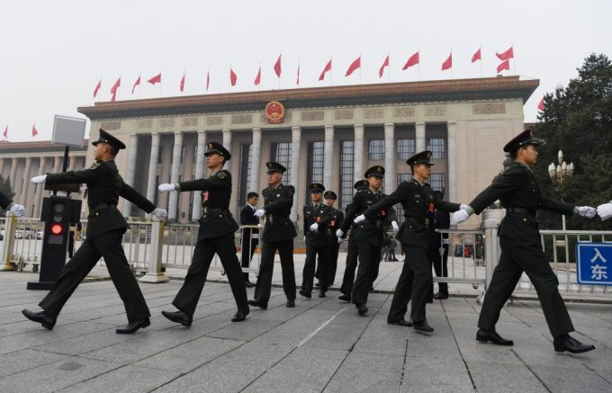 Chinese soldiers march outside the Great Hall of the People in Beijing, before the introduction of the Communist Party of China's Politburo Standing Committee, the nation's top decision-making body, on October 25, 2017. China on October 25 unveiled its new ruling council with President Xi Jinping firmly at the helm after stamping his authority on the country by engraving his name on the Communist Party's constitution. / AFP PHOTO / GREG BAKER (Photo credit should read GREG BAKER/AFP via Getty Images)