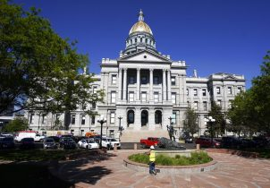 FILE - In this Friday, May 28, 2021, file photo, the morning sun shines on the State Capitol shines in downtown Denver. The Colorado Legislature ended its 2021 session this week after the Democrat-controlled Legislature pushed through a swath of progressive legislation on their agenda with little Republican support, following the aftermath of the coronavirus pandemic, multiple mass shootings in the state and a nationwide reckoning for racial justice. (AP Photo/David Zalubowski, File)
