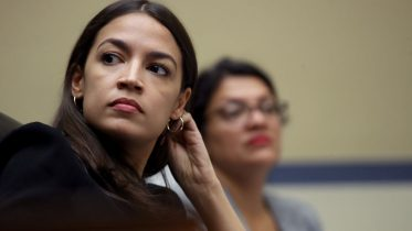 """WASHINGTON, DC - JULY 18: Rep. Alexandria Ocasio-Cortez (L) (D-NY) and Rep. Rashida Tlaib (D-MI) listen to testimony from acting Homeland Security Secretary Kevin McAleenan while he testifies before the House Oversight and Reform Committee on July 18, 2019 in Washington, DC. The hearing is on """"The Trump Administration's Child Separation Policy."""" (Photo by Win McNamee/Getty Images)"""