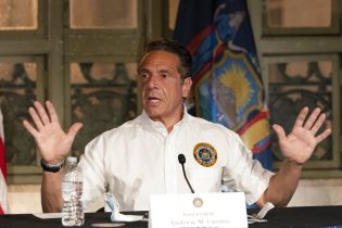 New York Gov. Andrew Cuomo discusses the East Side Access, a train tunnel that will connect rail yards in Queens with Grand Central Terminal, Thursday, May 27, 2021 in New York. (AP Photo/Mark Lennihan, Pool)
