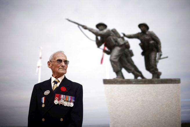 Veteran David Mylchreest, 97, poses prior to the official opening ceremony of the British Normandy Memorial at Ver-sur-Mer in France, Sunday June 6, 2021, on the anniversary of the D-Day landings. Several ceremonies took place on Sunday to commemorate the 77th anniversary of D-Day that led to the liberation of France and Europe from the German occupation. On June 6, 1944, more than 150,000 Allied troops landed on code-named beaches, carried by 7,000 boats. (Stephane Mahe/Pool Photo via AP