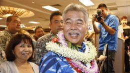 Hawaii Gov. David Ige greets supporters at his campaign headquarters on Aug. 11 in Honolulu. | Marco Garcia/AP Photo