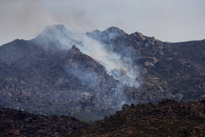 The Telegraph Fire burns Thursday, June 10, 2021 in Globe, Ariz. Arizona Gov. Doug Ducey has called a special session of the Legislature to boost wildfire funding as two large wildfires burn in south-central Arizona. (AP Photo/Mark Henle, Pool)