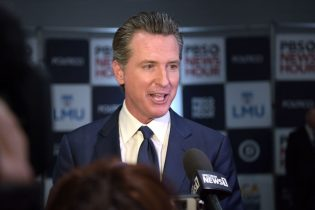 California Governor Gavin Newsom speaks to the press in the spin room after the sixth Democratic primary debate of the 2020 presidential campaign season co-hosted by PBS NewsHour & Politico at Loyola Marymount University in Los Angeles, California on December 19, 2019. (Photo by Agustin PAULLIER / AFP) (Photo by AGUSTIN PAULLIER/AFP via Getty Images)