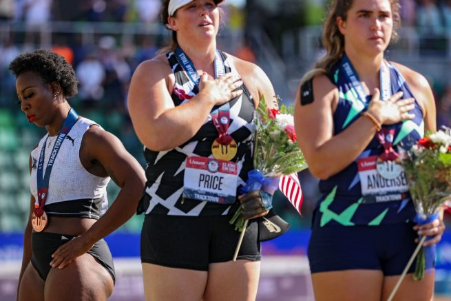 EUGENE, OREGON - JUNE 26: Gwendolyn Berry (L), third place, turns away from U.S. flag during the U.S. National Anthem as DeAnna Price (C), first place, and Brooke Andersen, second place, also stand on the podium after the Women's Hammer Throw final on day nine of the 2020 U.S. Olympic Track & Field Team Trials at Hayward Field on June 26, 2021 in Eugene, Oregon. In 2019, the USOPC reprimanded Berry after her demonstration on the podium at the Lima Pan-American Games. (Photo by Patrick Smith/Getty Images)