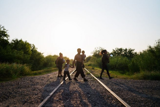 LA JOYA, TEXAS - JUNE 21: Immigrants walk towards border patrol after crossing the Rio Grande into the U.S. on June 21, 2021 in La Joya, Texas. A surge of mostly Central American immigrants crossing into the United States has challenged U.S. immigration agencies along the U.S. Southern border. (Photo by Brandon Bell/Getty Images)