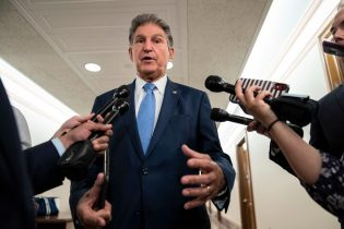 WASHINGTON, DC - JUNE 24: Sen. Joe Manchin (D-WV) speaks to reporters about infrastructure legislation on Capitol Hill June 24, 2021 in Washington, DC. A bipartisan group of Senators and White House negotiators have agreed on a framework for infrastructure legislation and will meet with President Joe Biden today. (Photo by Drew Angerer/Getty Images)