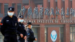 Security personnel keep watch outside the Wuhan Institute of Virology during the visit by the World Health Organization (WHO) team tasked with investigating the origins of the coronavirus disease (COVID-19), in Wuhan, Hubei province, China February 3, 2021. REUTERS/Thomas Peter/File Photo