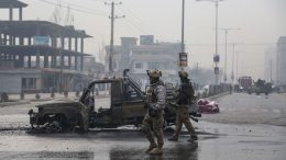 Members of the Afghan security forces stand at the site of an attack, in Kabul on December 20, 2020. - A car bomb killed eight people and wounded more than 15 others in Kabul on December 20, officials said, the latest attack to rock the Afghan capital. (Photo by Zakeria HASHIMI / AFP) (Photo by ZAKERIA HASHIMI/AFP via Getty Images)