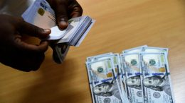 A man exchanges Nigeria's currency Naira for US dollars in Lagos, Nigeria, on April 19, 2021. - Nigeria's economy was already struggling with a fall in the price of oil, Nigeria's major export, and a weak local naira currency, before the global pandemic struck. Now Nigeria's inflation has soared to a four-year high of more than 18 percent in March 2021, with food prices up 22.9 percent, according to the National Bureau of Statistics. (Photo by PIUS UTOMI EKPEI / AFP) (Photo by PIUS UTOMI EKPEI/AFP via Getty Images)