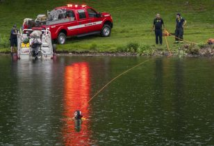 Worcester Fire Department divers search Green Hill Pond after reports of a drowning Friday, June 4, 2021. in Worchester, Mass. A Massachusetts police officer drowned Friday while attempting to rescue a teenage boy, who also drowned at the pond.(Rick Cinclair/Worcester Telegram & Gazette via AP)