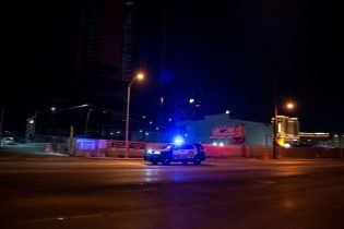 A police car makes its way to the scene after a shooting was reported outside Circus Circus hotel and casino, on June 1, 2020, in downtown Las Vegas, at the end of a rally in response to the recent death of George Floyd, an unarmed black man who died while in police custody. - Thousands of National Guard troops patrolled major US cities after five consecutive nights of protests over racism and police brutality that boiled over into arson and looting, sending shock waves through the country. The death Monday of an unarmed black man, George Floyd, at the hands of police in Minneapolis ignited this latest wave of outrage in the US over law enforcement's repeated use of lethal force against African Americans -- this one like others before captured on cellphone video. (Photo by Bridget BENNETT / AFP) (Photo by BRIDGET BENNETT/AFP via Getty Images)