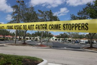 ROYAL PALM BEACH, FLORIDA - JUNE 10: Palm Beach County Sheriff's crime scene tape is seen outside of a Publix supermarket where a woman, child and a man were found shot to death on June 10, 2021 in Royal Palm Beach, Florida. Law enforcement officials continue to investigate the crime scene for clues as to why the shooting occurred. (Photo by Joe Raedle/Getty Images)