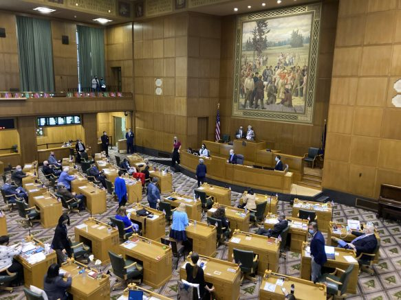 The Oregon House of Representatives get set to open a session on the evening of Thursday, June 10, 2021, to consider expelling member Rep. Mike Nearman for letting violent protesters into the Oregon Capitol in December. (AP Photo/Andrew Selsky)