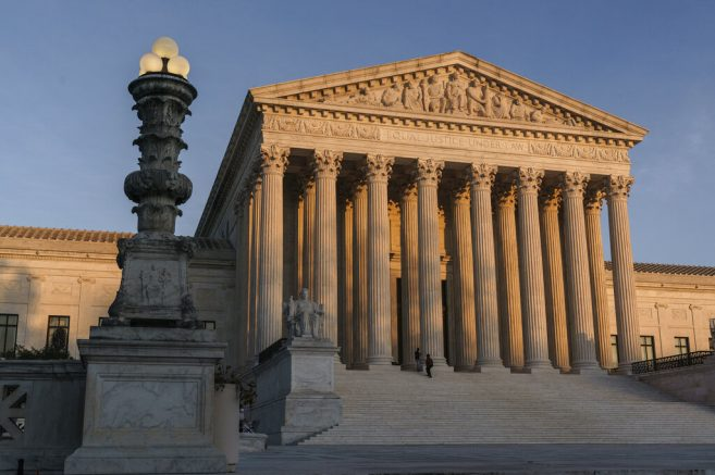 FILE - In this Nov. 6, 2020, file photo, the Supreme Court is seen at sundown in Washington. The state of California has agreed to pay more than $2 million in legal fees in a settlement with churches that challenged coronavirus closure orders. Church lawyers who successfully took their appeal to the U.S. Supreme Court said Wednesday, June 2, 2021, that the state agreed not to impose restrictions on houses of worship that are greater than those on retail businesses. (AP Photo/J. Scott Applewhite, File)