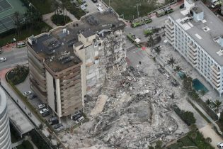 This aerial photo shows part of the 12-story oceanfront Champlain Towers South Condo that collapsed early Thursday, June 24, 2021 in Surfside, Fla. (Amy Beth Bennett /South Florida Sun-Sentinel via AP)
