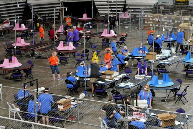 Maricopa County ballots cast in the 2020 general election are examined and recounted by contractors working for Florida-based company, Cyber Ninjas, at Veterans Memorial Coliseum in Phoenix. (AP Photo/Matt York, Pool, FIle)