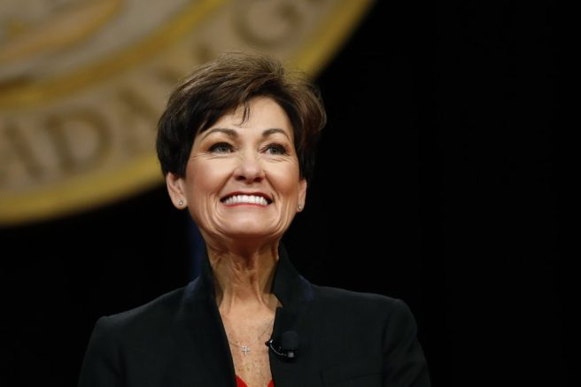 Iowa Gov. Kim Reynolds smiles as she prepares to deliver her inaugural address, Friday, Jan. 18, 2019 in Des Moines, Iowa. (AP Photo/Charlie Neibergall)