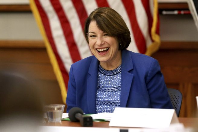 U.S. Sen. Amy Klobuchar laughs during her roundtable with veterans at Carnegie-Stout Public Library in Dubuque. (Eileen Meslar/Telegraph Herald via AP)