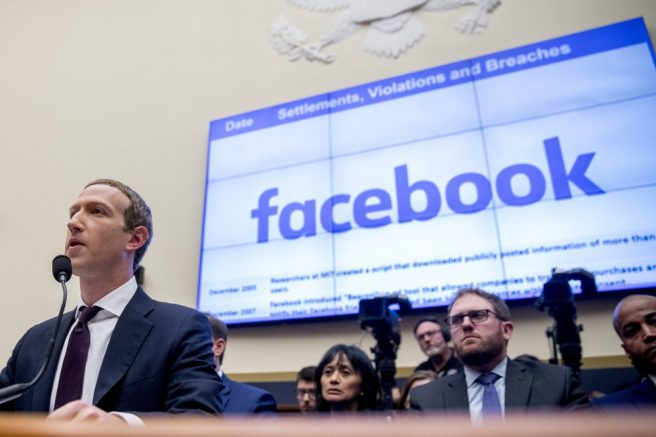Facebook CEO Mark Zuckerberg testifies before a House Financial Services Committee hearing on Capitol Hill in Washington. (AP Photo/Andrew Harnik, File)