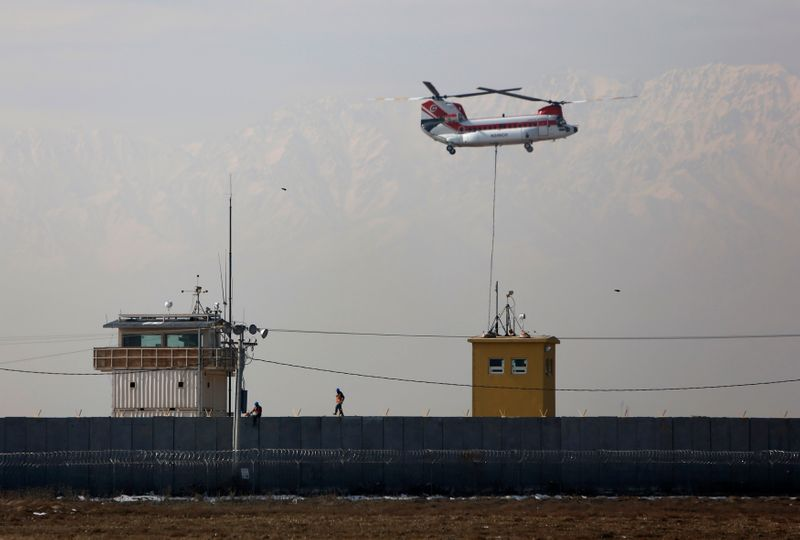 FILE PHOTO: Chinook helicopter flies over the Bagram Air Base north of Kabul