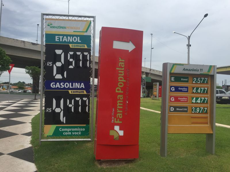 FILE PHOTO: A placard shows prices for ethanol and gasoline at a gas station in Cuiaba